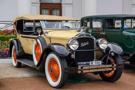 BADEN BADEN, GERMANY - JULY 2019: yellow beige black PACKARD PHAETON MODEL 640 cabrio roadster 1929, oldtimer meeting in Kurpark.