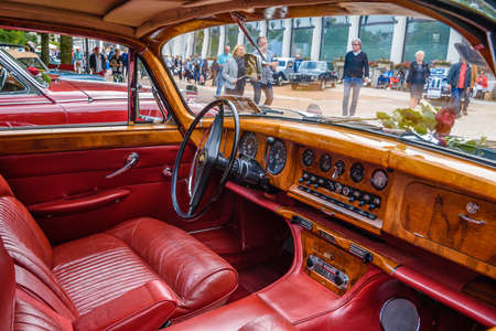 BADEN BADEN, GERMANY - JULY 2019: red leather wooden interior of JAGUAR MARK X 420G 1961 1970 sedan limousine, oldtimer meeting in Kurpark.
