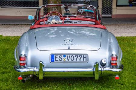 BADEN BADEN, GERMANY - JULY 2019: silver gray MERCEDES-BENZ 190 SL roadster cabrio 1955 1963, oldtimer meeting in Kurpark.