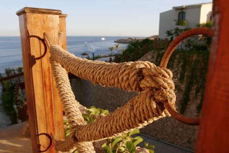 dependance: sunny rope on the seaside Stock Photo