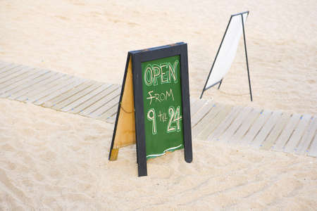 opening hours: A photo of Beach bar board with opening hours