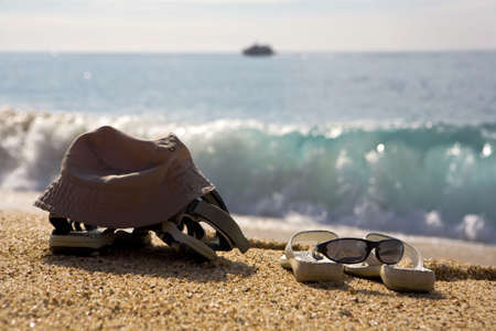 sunnies: a photo of two pairs of beach shoes at the seaside