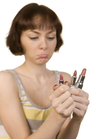 personal decisions: a photo of a young girl choosing a lipstick Stock Photo