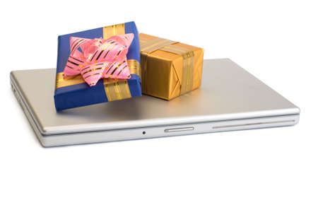 a photo of some gift boxes over laptop
