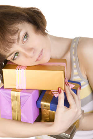 a close- up of sad girl with gifts over white photo