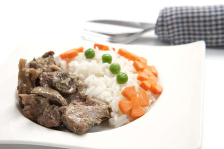 Chicken with rice, green peas and carrot photo