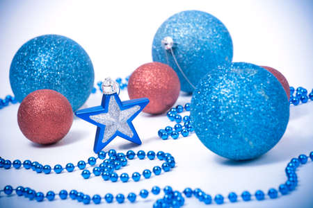 a photo of Blue and Red Christmas baubles and star photo