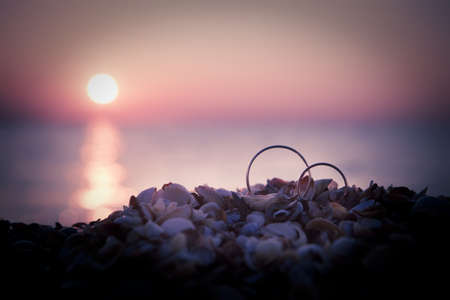forever: Picture of two wedding rings on seaside