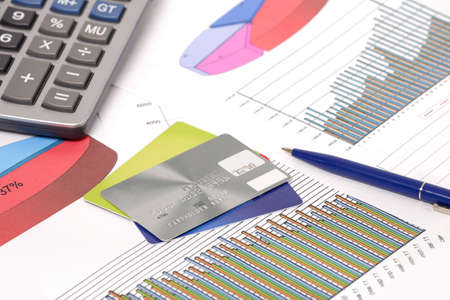 research paper: Photo of document some graphics   pen and calculator and credit cards Stock Photo