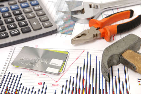 housebuilding: a photo of housebuilding graphics and hammer and credit cards Stock Photo