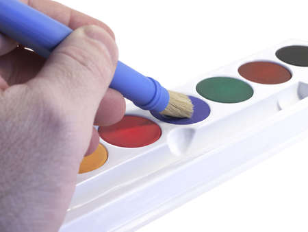 Brush tips into set of primary colors for water color painting. Standard-Bild