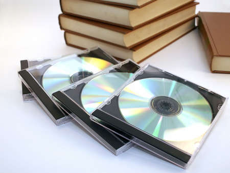 CDs in cases with old leather bound books.