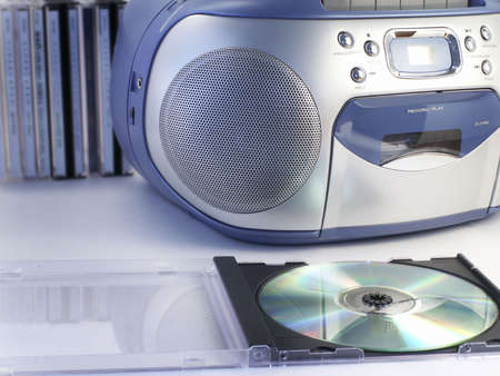 CD case stand open, ready to play, with one speaker of boombox, and more tapes in background.