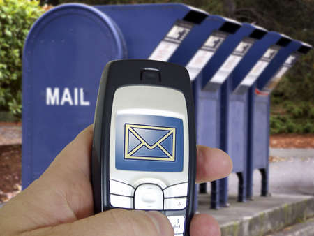 New technology email from cell phone contrasts with a bank of old mail boxes in background.