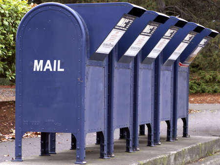 Row of mail boxes await letter drops.
