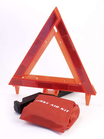 Auto-safety warning triangle, with red first aide kit on white background.