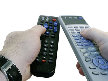Two remote controls for TVcable in mans hands -- isolated on white background.