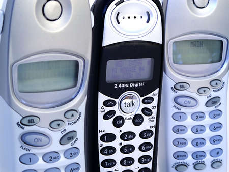 Close-up of modern telephone handsets.