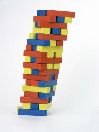 Tower of blocks leans perilously to the right.