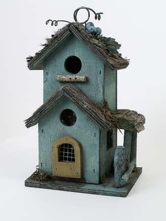 Weathered wooden birdhouse, isolated on white background.