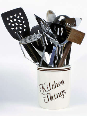 Jar of Kitchen Things holds cooking tools including potatoe masher, spatulas, meat tenderizer, and wooden spoons. Reklamní fotografie