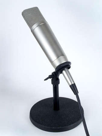 Professional studio cardioid microphone on table stand, isolated against white backround.