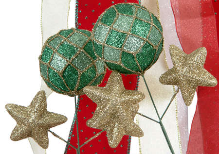 Two green glittering bauble balls with gold stars against backdrop of metallic ribbons Standard-Bild