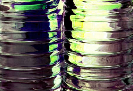 Abstract photo close-up of ribbed liquid containers with interesting green backlight. Standard-Bild