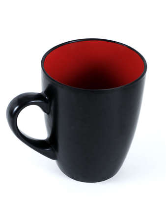 Black coffee mug with red interior isolated on white background.
