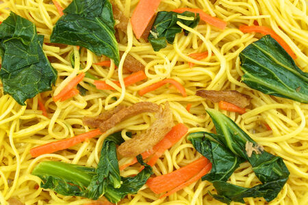 Long life noodle fried with kale, carrots and vegan protein dry. photo