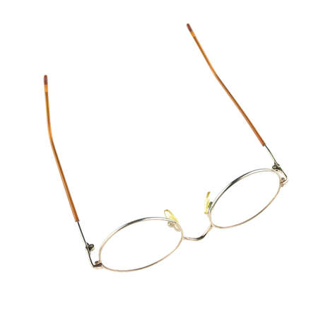 upturned: Old glasses for problem vision put upturned isolated with white background.