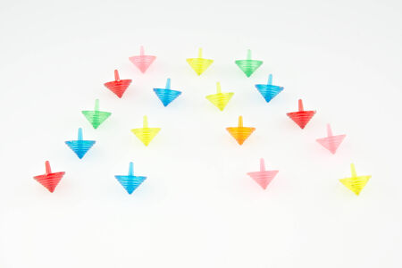 Red, green, blue, pink and orange gyroscopes on white background. photo