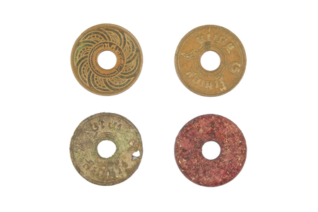 Old ancient coins of Thailand decay isolated with white background. photo