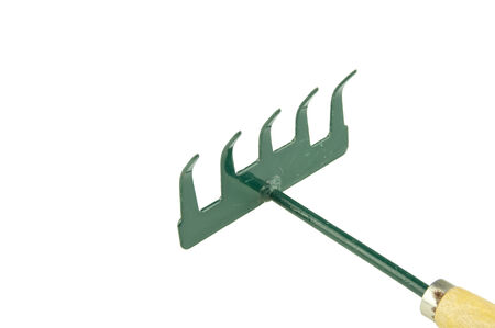 harrow: Green harrow placed face with wooden handle on bottom right isolated with white background. Stock Photo