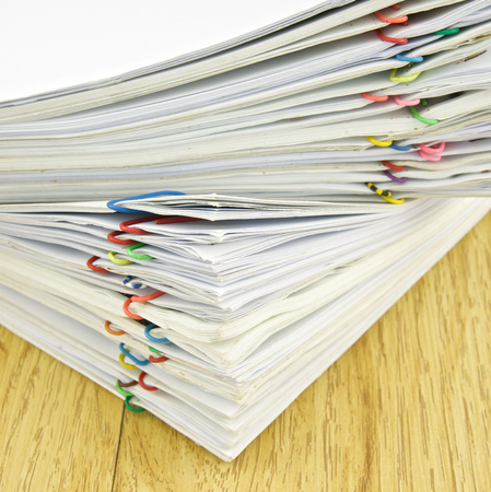 include: Stack of account include sales and receipt place on wood background