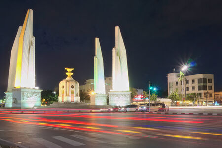 democracy monument: Traffic light at night from automobile on intersection of Democracy Monument. Stock Photo