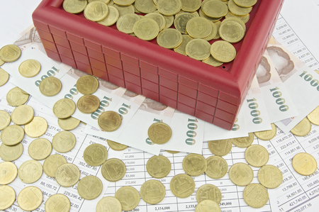 red bills: Gold coins and red treasure box on bills and finance account. Stock Photo