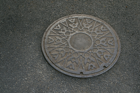 drain water: Metal circle of drain water on the floor of pavement.