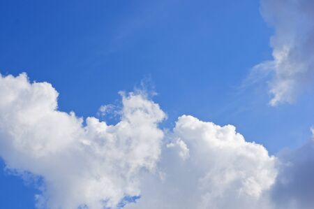 nebulosity: White cloud on left bottom of blue sky as a background.