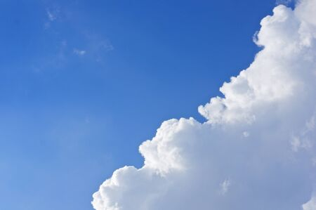 nebulosity: White cloud on right bottom of blue sky as a background.