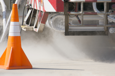 chemically: Cold metal pipe and smoke from transferring liquid oxygen at rear of truck. Stock Photo
