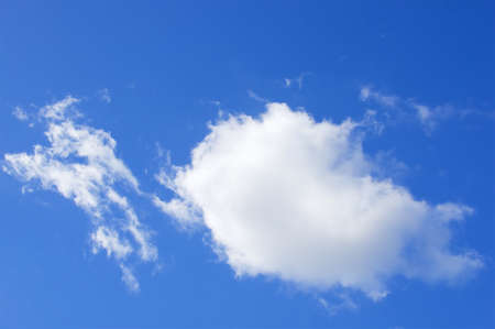 tranquil atmosphere: Big white puffy cumulus cloud on the blue sky as background. Stock Photo