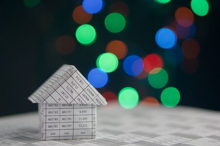 recibo: House on finance account has colorful bokeh circle or defocused of glitter at night as background.