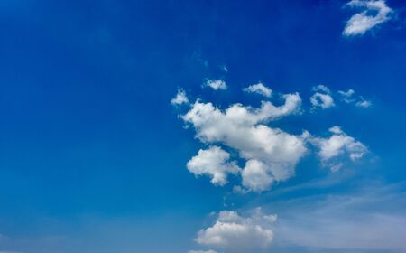White fluffy cloud on blue sky as a beauty nature background with copy space. Imagens