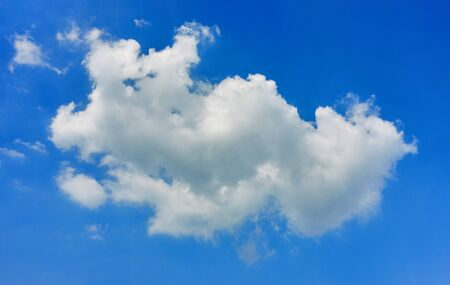 White fluffy cloud on blue sky as a background with copy space. Imagens