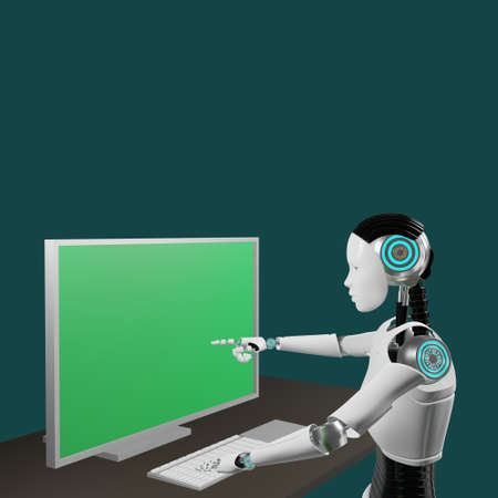 Robot is pointing at monitor of computer with green screen on table