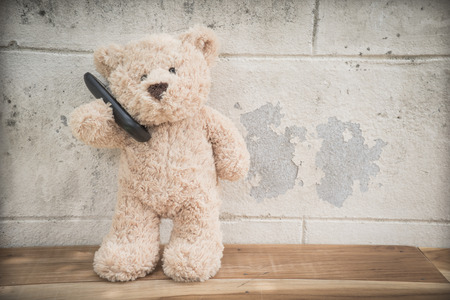 teddybear talking on mobile phone