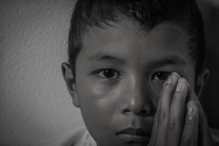 sweet heart: Young Asian homeless child looking scared, alone and in need of help Stock Photo