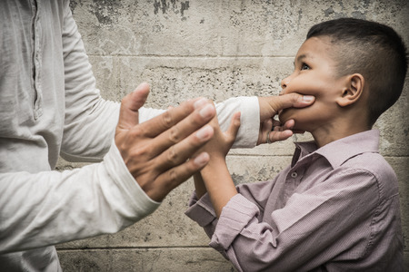 alone: Young Asian boy being physically abused by someone older than him