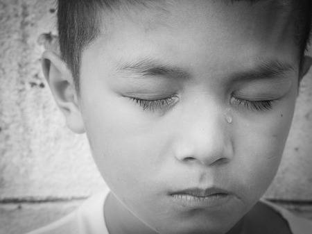 Young Asian homeless child looking scared, alone and in need of help Zdjęcie Seryjne